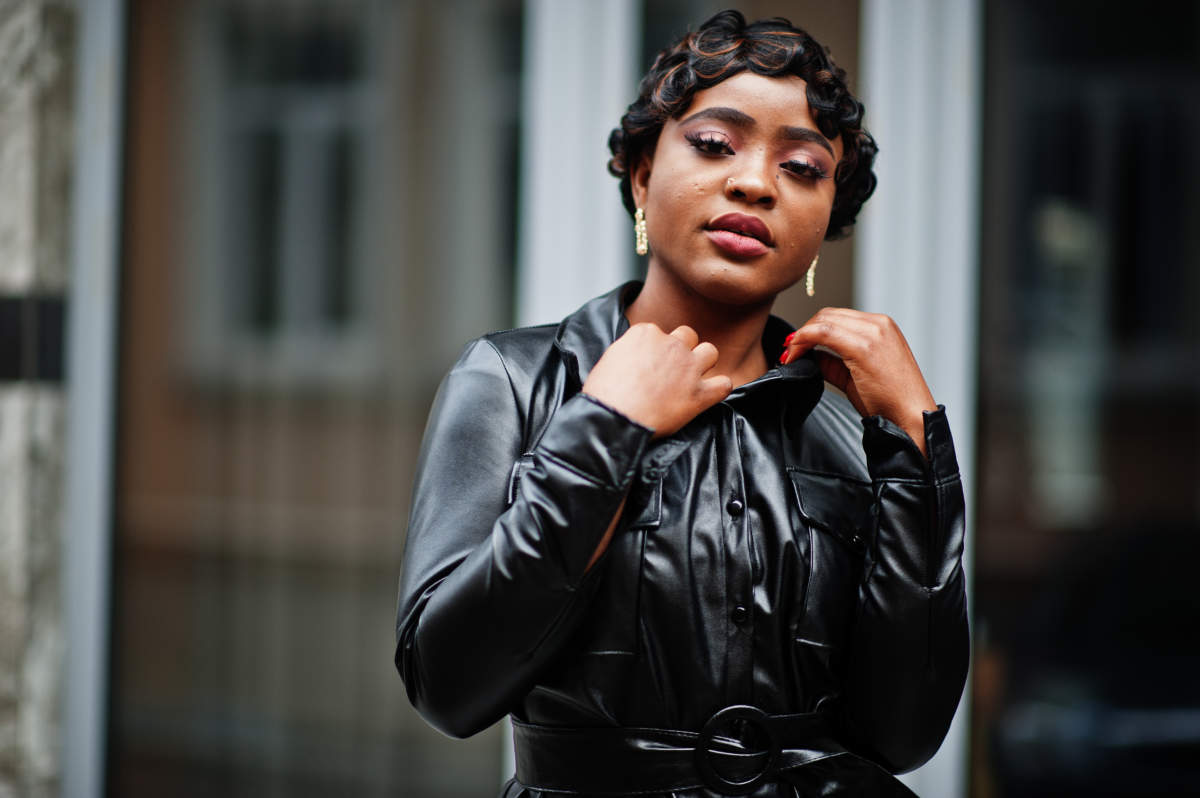 beautiful African american woman wearing a fake leather jacket