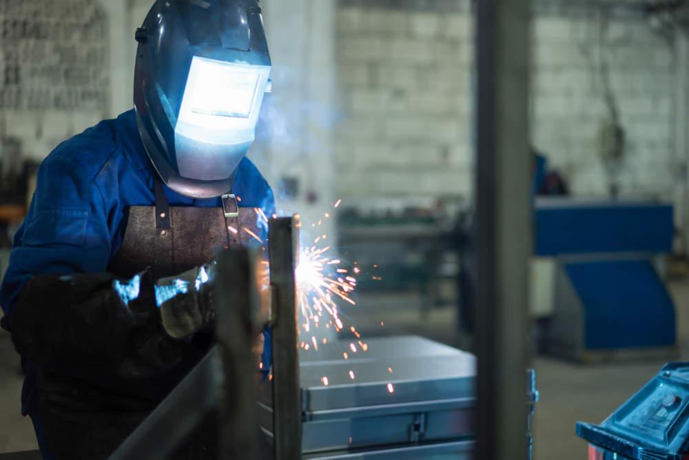 welder wearing leather apron