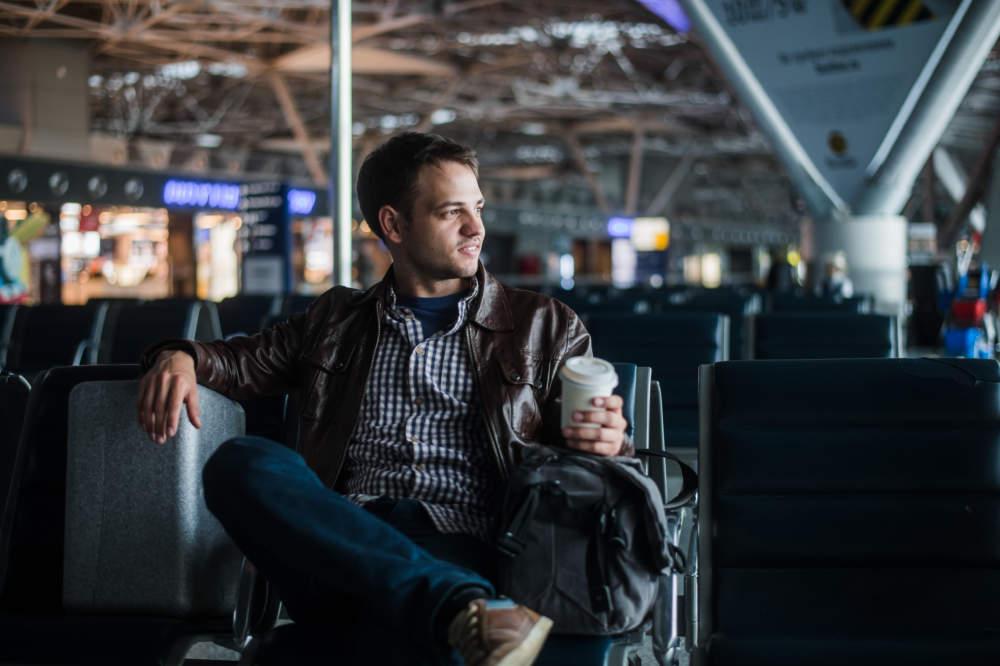 man at airport with bag
